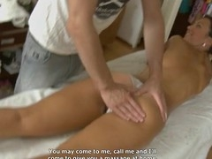 Youthful masseur is getting a hard boner from massaging playgirl